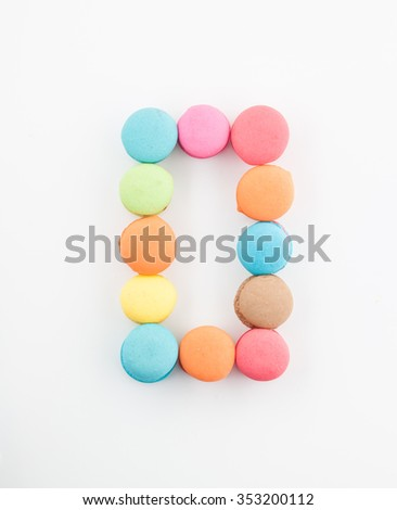 colorful macarons arrangment is number zero,on white background
