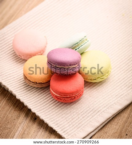 colorful macarons on Napery background - stock photo
