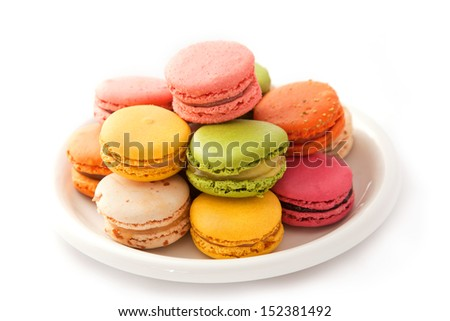 Colorful macarons on the white plate - stock photo
