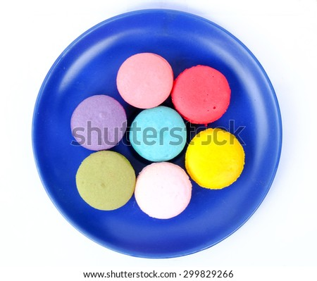 colorful macaroon on blue plate