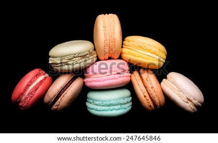 Colorful macaroon over black background - stock photo