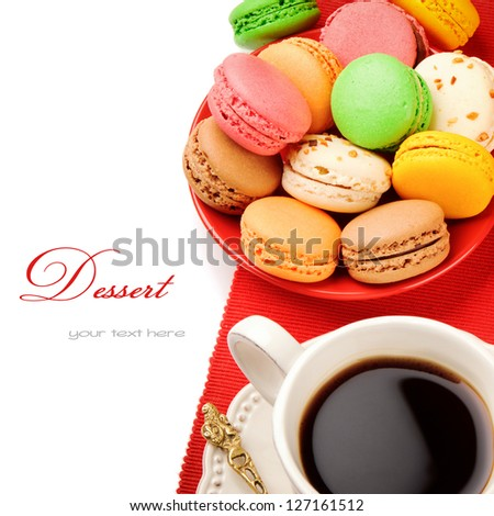 Colorful macaroons and coffee isolated over white - stock photo