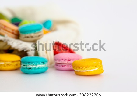 Colorful macaroons in the basket white background, selective focus, soft focus