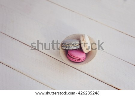 Colorful macaroons on white wooden background, from above. Place for text.  - stock photo
