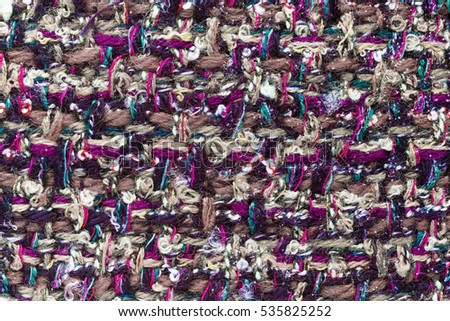 Colorful (main color violet) hand weaving matting tweed fabric texture. Closeup horizontal fragment
