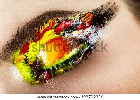 Colorful make-up on close-up eye. Art beauty image.  - stock photo