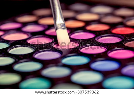 Colorful makeup palette with makeup brush,color filter - stock photo