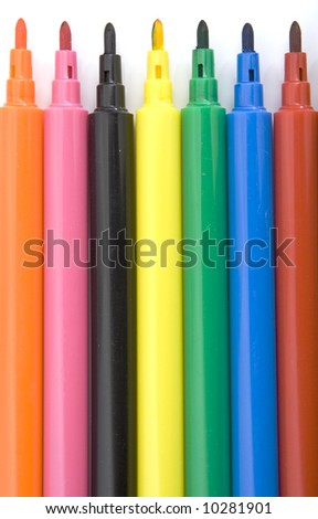 colorful markers isolated against white background