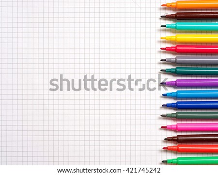 Colorful markers on notebook. Painting with crayons and markers. - stock photo