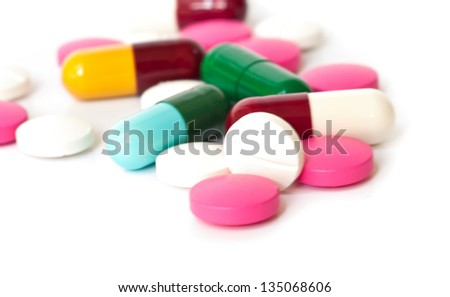 Colorful medical  pills and capsules on white background. - stock photo