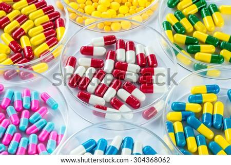 colorful medicament in Petri Dish,  Healthcare And Medicine healthcare medicament - stock photo