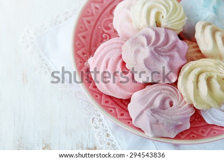 Colorful merengue, different tastes, on a wooden rustic background,.Selective focus - stock photo