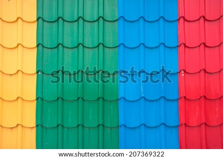 colorful metal sheet of roof tile for home building - stock photo