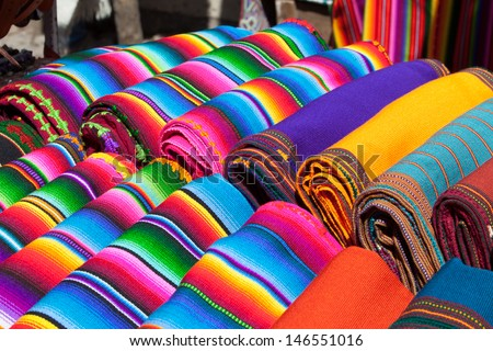 Colorful Mexican blankets for sale at market  - stock photo