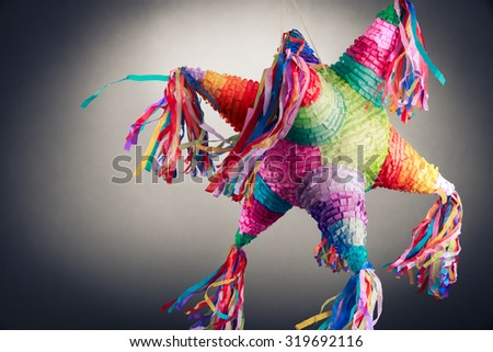 """Colorful mexican """"piñata"""" or pinata used in birthdays on a grey background - stock photo"""