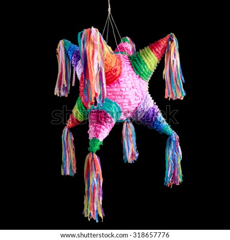 Colorful mexican pinata used in birthdays isolated on black - stock photo