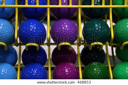 Colorful mini golf balls - stock photo