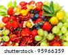 colorful mix of fresh fruits and berries. strawberry, physalis, grapes, orange, blueberry, cherry - stock photo