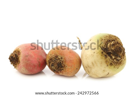 colorful mix of red,yellow and white beets on a white background - stock photo
