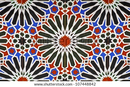 Colorful moorish glass mosaic tile with floral and star patterns. - stock photo