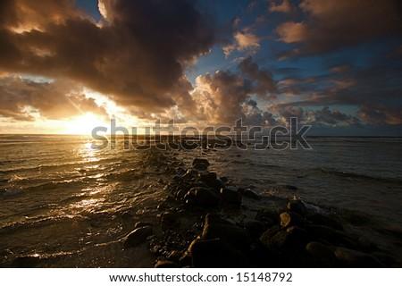 Colorful morning sunrise over the Hawaiian island of Kauai - stock photo