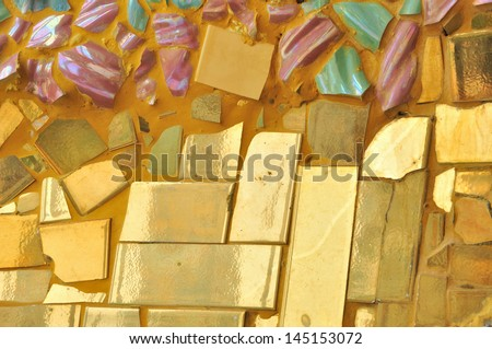 colorful mosaic and ceramic broken tile wall background - stock photo