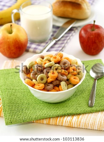colorful muesli in  bowl, glass of milk and apples - stock photo