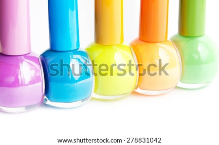 Colorful nail polish on white background with copy space. Macro with shallow dof. Selective focus on yellow. - stock photo