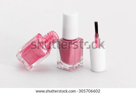 Colorful nail polish - white background, pink style - stock photo