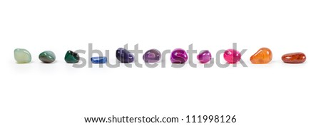 Colorful natural gem stones alighed and Isolated on white - stock photo