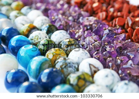 Colorful natural stones necklaces picture. - stock photo