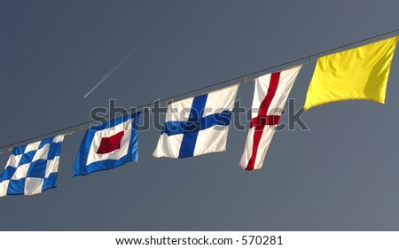 Colorful nautical flags hanging on a rope
