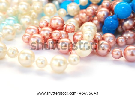 Colorful necklaces on white background.