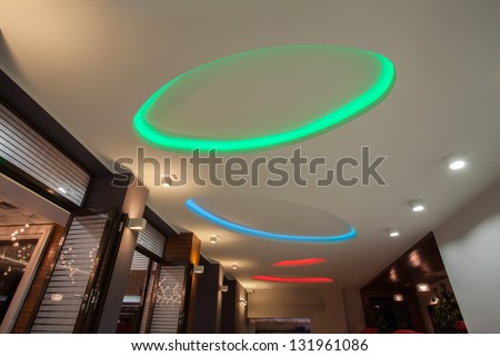 colorful neon lights on hall ceiling - stock photo