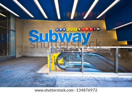 Colorful New York City subway with escalator at 42nd Street in Midtown Manhattan - stock photo