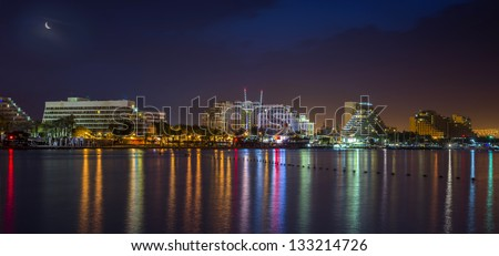 Colorful night view on central beach of Eilat - famous resort and recreation city in Israel - stock photo