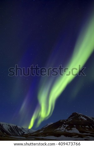 Colorful Northern Lights over mountains - stock photo
