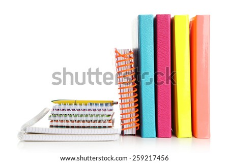 Colorful notebooks and pen, isolated on white - stock photo