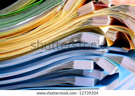 Colorful notebooks that are isolated on white Background.