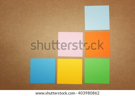 Colorful notes on cardboard background