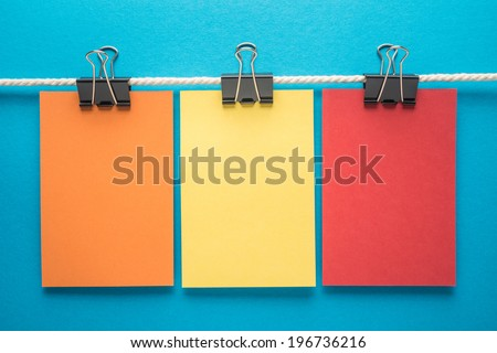 Colorful notes paper on blue background - stock photo