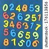 Colorful numbers on school desk background - stock photo