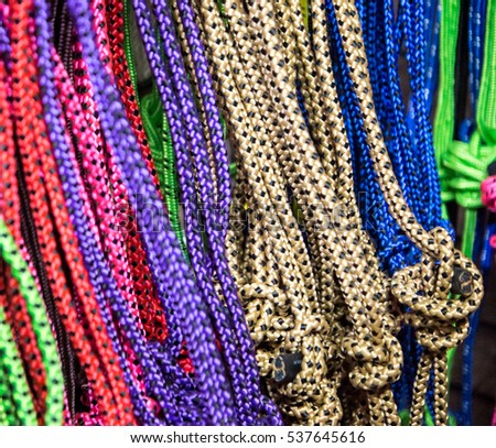 Colorful nylon braided rope used in ranching, rodeo and horsemanship.