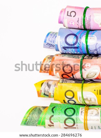Colorful of Australian Dollars roll with all denomination on white background - stock photo