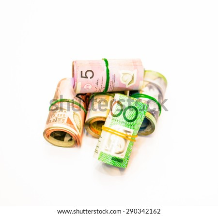 Colorful of Australian Dollars roll with all denomination on white background,Focus on five dollar notes - stock photo