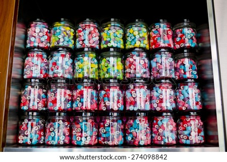 Colorful of Candy in a glass candy jar background - stock photo