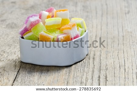 Colorful of candy jelly in white box put on wooden background.Shallow DOF. - stock photo