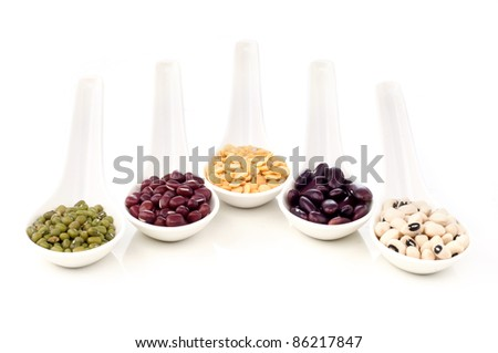 Colorful of dry legumes on white spoon isolated white background - stock photo