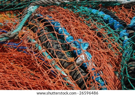 colorful of fisherman's nets on the quay in Dingle harbor - stock photo