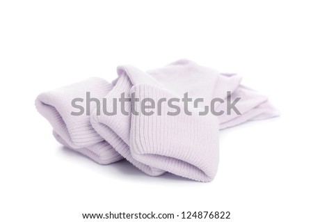 colorful of new kid's baby socks stacked and isolated on white background